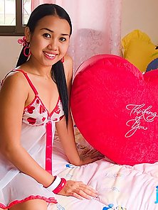Asian cutie shows titties in special Valentine Day lingerie