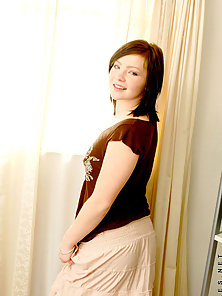 Lovely camille standing besides window alluring with a cute smile