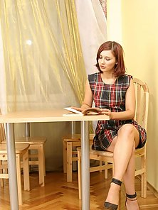 Playful redhead shows off her virginity