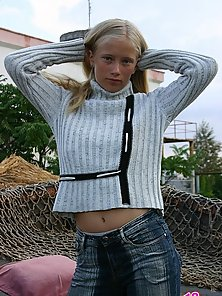 Flexible blonde virgin Anna is not shy to reveal her intimate areas an