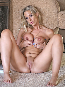 Anilos cougar spreads lotion on her elongated nipples and her ample milf breasts
