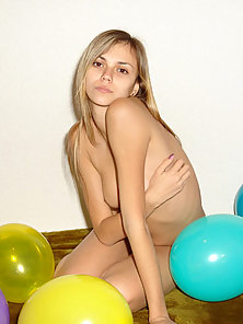 See this shining teen strips off to play naked with her balloons