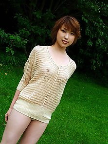 Cute girl from Japan takes off her sweater and runs in the grass naked with her trimmed hairy beaver