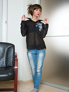Blue Eyes Babe in Jean Showing Her Slim Figure on Black Chair