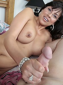 Hot and horny momma wearing glasses is a handjob legend
