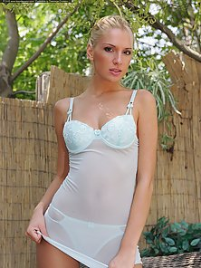 Ponytail Blonde Strips Her White Lingerie and Exposes Her Naked Body in Standing Position