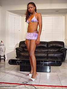 Black beauty by the couch strips her undies