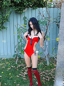 Attractive teen Samantha Stone teases us with her sexy outfit outdoors