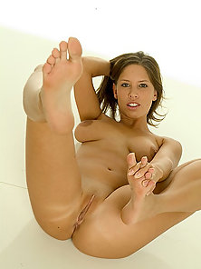 Cute sexy brunette foot fucks for a creamy load all over her toes