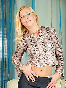 Enticing blonde milf Janet flaunts her tight cougar body in a sexy sheer bra and pantie set