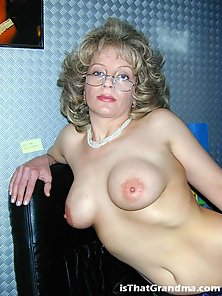 Mature secretary showing her boobies in the office