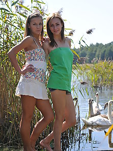 Dashing Two Blonde Coeds Posing and Exposing Bare Figures at Outdoor