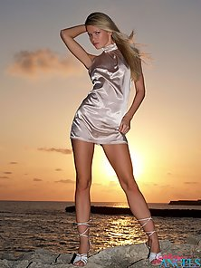 Sensual blonde glamour girl goes nude during the sunset