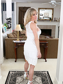 Blonde Mommy Lifts Up Her Dress To Show Off Her Sexy Thong