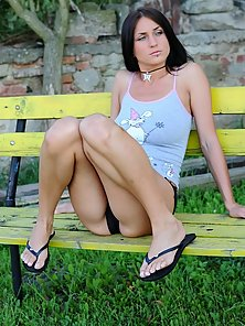 Alina is sitting on the bench and you can see her pussy.