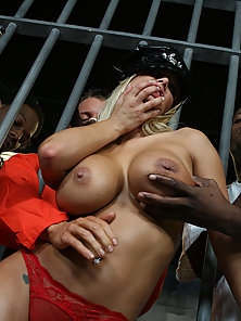 Busty blonde Shyla strips and fucks a couple guys in prison
