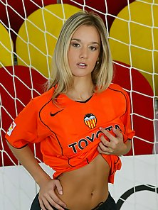Naughty Blonde Gives Pose on the Football Ground