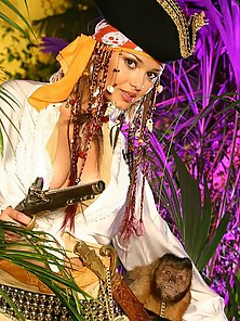 Pornstar Lenka dressed up like a pirate revealing her nice tits and furrt pussy