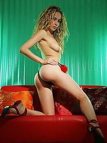 Busty Blonde Chick Lillien Ramirez Exposes Her Attractive Bare Figure on Couch