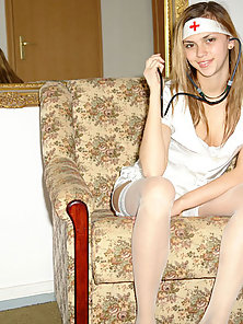 Brunette teen nurse in pantyhose posing great on couch