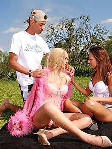 Fair haired shemale nailing a couple in the outdoors
