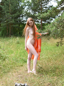 Skinny Blonde Chick Reveals Her Tattooed Bare Figure at Outdoor