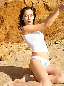 Topless nansy loves getting her flawless skin tanned in the beach