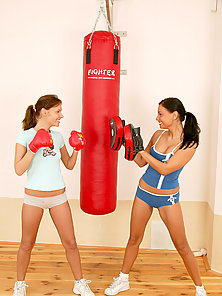 Two boxing lezzies toying their wet pussy together
