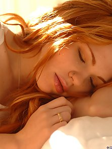 Red head gets naked in her bedroom