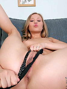 Mirjam spreads her pink pussy and stuffs her fingers inside on the cou