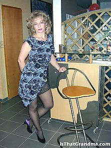 Slutty grandma Laura teasing us with her stocking at the bar
