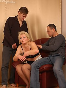 Blonde housewife in stockings pleasing two guys