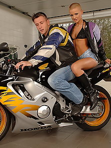 Handsome biker boy gives a lift to sexy biker girl