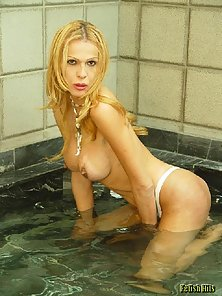 Horny Blonde Tranny Spreads Legs in Bathtub