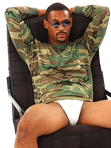 Ebony GI Joe in aviator shades and a sexy jock strap