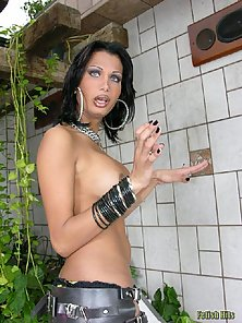 Naughty shemale brunette beauty in leather