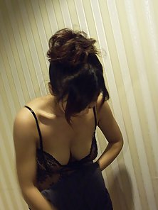 Big titted Japanese teenager gives an erotica soapy massage