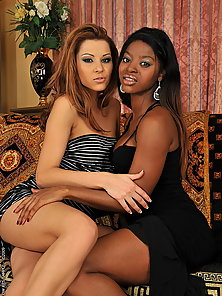 A black and a white girl having hot lesbian sex