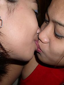 Two young Filipina lesbos finger and kiss each others shaved pussies