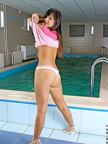 Stunning girl next door flashing panty through her lowcut pink polkado