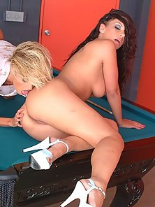 Hottys licking each other on the pool table