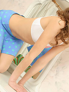 Absolutely fresh teen flashing her floral panty and a well-formed ass