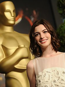 Gorgeous Anne Hathaway wearing cleavage exposing sexy outfits