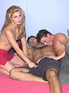 Blonde chick gets caught up in a bisexual threesome orgy session