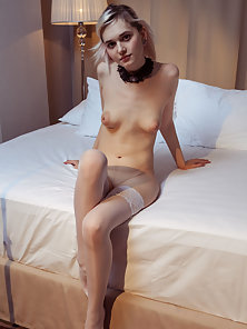 Stocking Wearing Skinny Girl Reveals Her Hairless Fanny on Bed