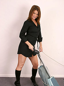 Elegant redhead mom in black boots and business attire drop dead gorgeous while vacuuming the floor