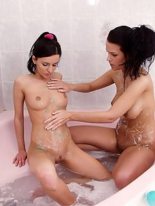 Brunettes showing off tits and clit while bathing