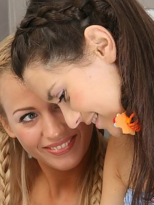 Two tasty teen girls lick and finger each other in the bathroom