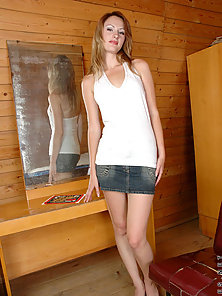 See jana in jeans skirt showing her smooth legs and stunning upskirt o