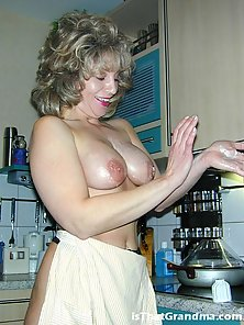 Busty grandma Laura teases us with her stockings